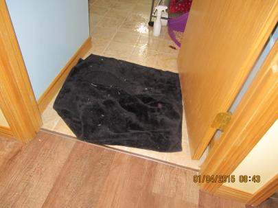 """Flat"" blankie in doorway"